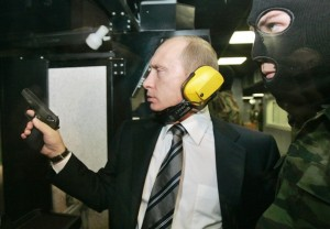 Russian President Vladimir Putin holds a